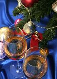Glass of white wine on a beautiful christmas background Stock Images