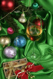 Glass of white wine on a beautiful christmas background Stock Image