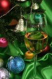 Glass of white wine on a beautiful christmas background stock photos
