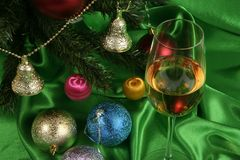 Glass of white wine on a beautiful christmas background Stock Photo