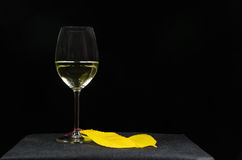 Glass of white wine at black background Royalty Free Stock Photo