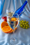 Glass of white wine and blue bottle Royalty Free Stock Photo