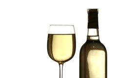 Glass of white wine with bottle. Backlit against white background Stock Photography