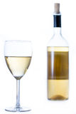 Glass of white wine with a bottle. In the background isolated on white Royalty Free Stock Images