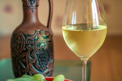 Glass of white wine and bottle. close-up royalty free stock photo