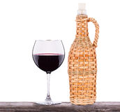 Glass of white wine and a bottle isolated Stock Images