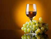 A glass of white wine and a bunch Royalty Free Stock Photo