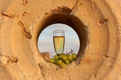Glass of white wine and a bunch of grapes Royalty Free Stock Photo