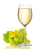 Glass of white wine and a bunch of ripe grapes isolated. On white Stock Photos