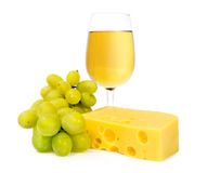 Glass of white wine with cheese and grapes Stock Image