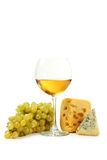 Glass of white wine, cheeses and grapes isolated on a white Royalty Free Stock Photography