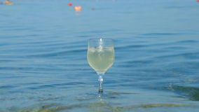 Glass of white wine by the coast.on the rocks, Stock Photos