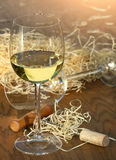 Glass of white wine with cork screw Royalty Free Stock Images