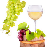 Glass of white wine with grape on a wooden barrel Royalty Free Stock Photo