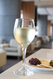 Glass of white wine with grapes. Photograph of a glass of white wine with grapes royalty free stock images