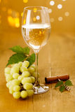 Glass of white wine and grapes Stock Photo