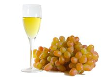 Glass of white wine and grapes Royalty Free Stock Images