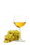 Glass of white wine with grapes isolated on a white Stock Photo