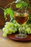 Glass of white wine with grapes Royalty Free Stock Photography