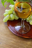 Glass of white wine with grapes Royalty Free Stock Photo
