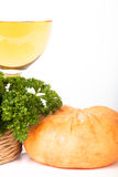 Glass of white wine, head cheese, and parsley in a basket on a w Royalty Free Stock Photos