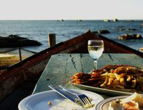Glass of white wine and plate seafood, selective focus Royalty Free Stock Photos