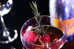 Glass of white wine with a raspberry royalty free stock photos
