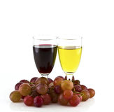 A glass of white wine, red wine and grapes Royalty Free Stock Photography