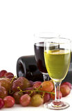 A glass of white wine, red wine and grapes Stock Photos