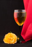 Glass of white wine and rose Royalty Free Stock Image