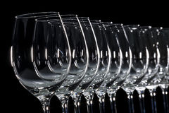 Glass white wine. In a row royalty free stock image