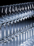 Glass white wine. In a row on a white glass table royalty free stock photos