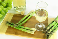 Glass of white wine and sides. Royalty Free Stock Photography