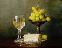 A glass of white wine, soft cheese and grapes Stock Photography