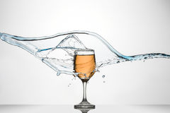 Glass of White Wine with splash. Stock Photos