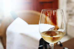 Glass of White Wine in Street Cafe Royalty Free Stock Image