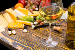 Glass of White Wine on Table with Cheese and Fruit Stock Photos