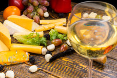 Glass of White Wine on Table with Cheese and Fruit Royalty Free Stock Photos