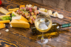 Glass of White Wine on Table with Cheese and Fruit Royalty Free Stock Image
