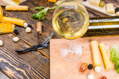 Glass of White Wine on Table with Fruit and Cheese Stock Photos