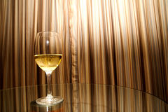 Glass of white wine on a table Stock Photo