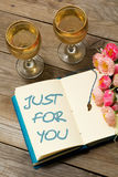 Glass of white wine and text in Notepad: Just for you Royalty Free Stock Photography