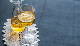 Glass of white wine in vintage decor Royalty Free Stock Photography