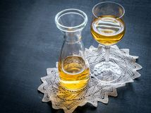 Glass of white wine in vintage decor Stock Photo