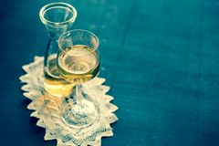 Glass of white wine in vintage decor Stock Image