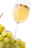 Glass of white wine and white grapes on white Royalty Free Stock Photos