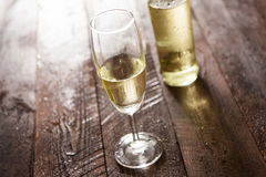 Glass of white wine on wooden table Stock Images