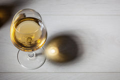 Glass of white wine on wooden table Royalty Free Stock Images