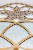Glass window decorated with golden geometric form in Sheikh Zayed Grand Mosque with blue sky in the morning at Abu Dhabi, UAE Royalty Free Stock Photos