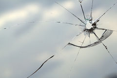 Glass  window  hole  cracks Royalty Free Stock Photo
